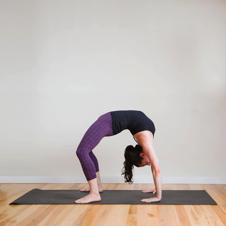 "<p>You can work up to this challenging posture with these <a href=""https://www.popsugar.com/fitness/How-Do-Wheel-Pose-1054126"" class=""link rapid-noclick-resp"" rel=""nofollow noopener"" target=""_blank"" data-ylk=""slk:five poses that prepare you for Wheel"">five poses that prepare you for Wheel</a>.</p> <ul> <li>From Bridge, return to lie flat on your back.</li> <li>Bend your knees and place your feet flat on the ground (heels as close as possible to your bum). Bend your elbows, and place your palms flat on the ground above your shoulders, fingertips facing your feet.</li> <li>Inhale, press into your palms, and lift your head, shoulders, and hips off the mat, straightening your arms and legs. Try to walk your hands and feet a little closer together.</li> <li>Stay here for five deep breaths, and then slowly lower your body down. Eventually you want to do this pose a total of three times. Hug your knees into your chest to release your lower back. </li> </ul>"