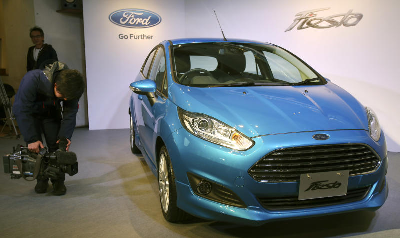 A TV cameraman films a Ford Fiesta during a press conference in Tokyo,Thursday, Jan. 9, 2014. Ford's Fiesta compact is back in Japan despite failing a decade ago in a market dominated by Toyota and other powerful local brands that specialize in small cars. (AP Photo/Koji Sasahara)