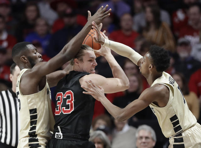 North Carolina State's Wyatt Walker (33) is trapped by Wake Forest's Isaiah Mucius (1) and Ikenna Smart (35) during the first half of an NCAA college basketball game in Winston-Salem, N.C., Tuesday, Jan. 15, 2019. (AP Photo/Chuck Burton)