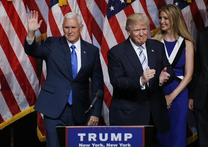 Donald Trump applauds after introducing Indiana Gov. Mike Pence as his vice presidential running mate. (Photo: Carlo Allegri/Reuters)