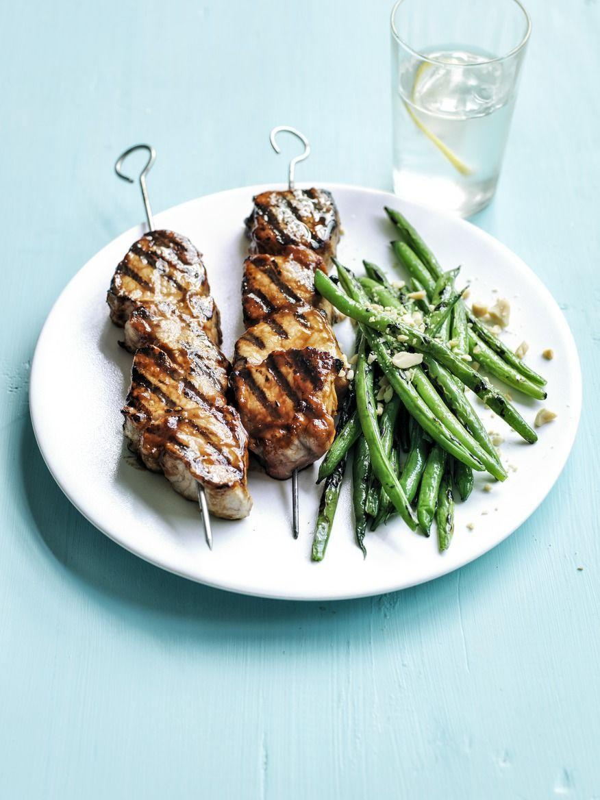 """<p>Give pork skewers big flavor with this sweet and savory glaze made from peanut butter, ketchup, honey, and soy sauce. </p><p><a href=""""https://www.womansday.com/food-recipes/food-drinks/recipes/a55355/peanut-butter-barbecue-pork-kebabs-recipe/"""" rel=""""nofollow noopener"""" target=""""_blank"""" data-ylk=""""slk:Get the Peanut Butter Barbecue Pork Kebabs recipe."""" class=""""link rapid-noclick-resp""""><em>Get the Peanut Butter Barbecue Pork Kebabs recipe.</em></a><br></p>"""