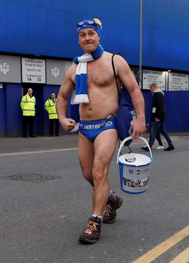 "Soccer Football - Premier League - Everton v Newcastle United - Goodison Park, Liverpool, Britain - April 23, 2018 Everton fan in swimming trunks raising money for charity outside the stadium before the match Action Images via Reuters/Lee Smith EDITORIAL USE ONLY. No use with unauthorized audio, video, data, fixture lists, club/league logos or ""live"" services. Online in-match use limited to 75 images, no video emulation. No use in betting, games or single club/league/player publications. Please contact your account representative for further details."