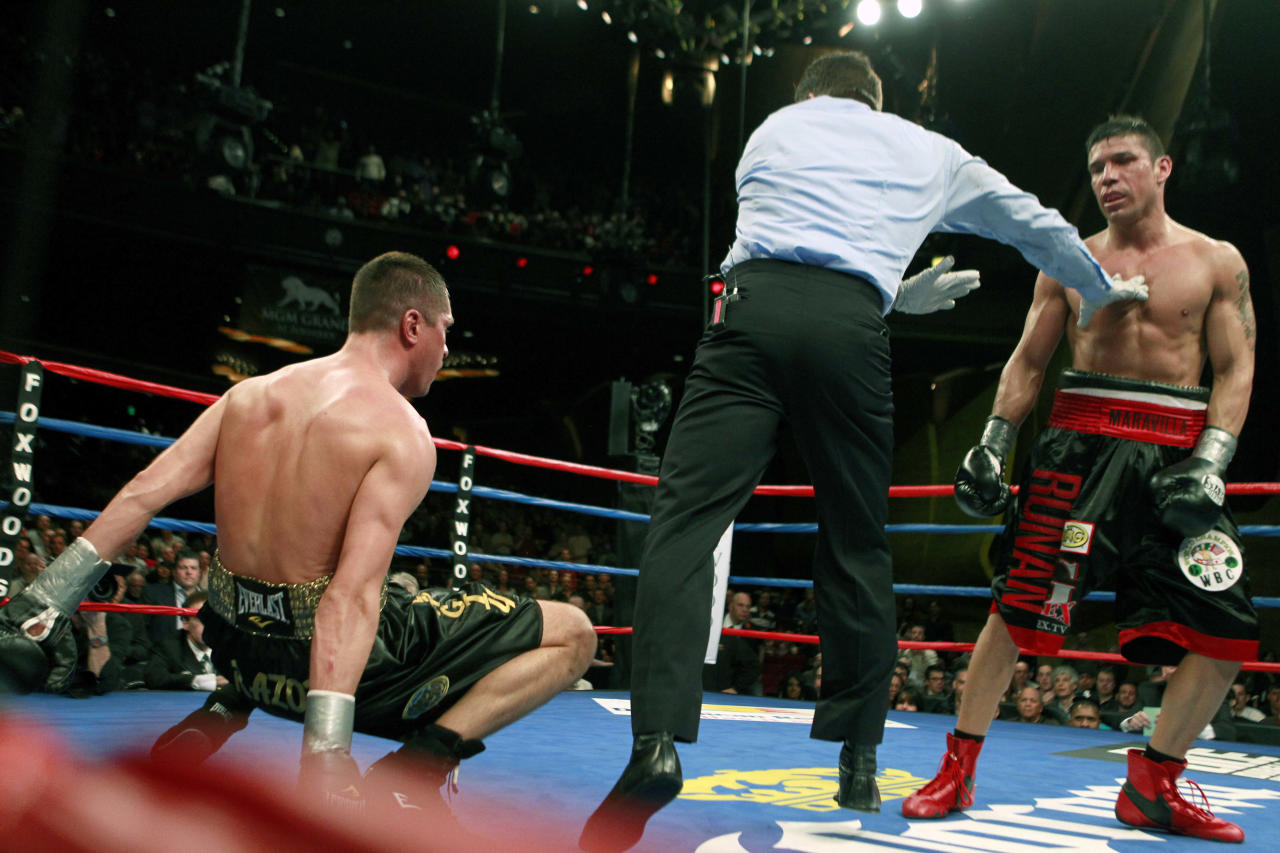 The referee waves off Sergio Martinez, right, before stopping the fight after Martinez knocked down Sergiy Dzinziruk, left, of Germany, in the eighth round of their WBC middleweight title boxing match in Mashantucket, Conn., early Sunday morning, March 13, 2011. Martinez won in the eighth round on a TKO.