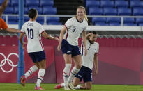 United States' Samantha Mewis, center, celebrates after scoring against Netherlands during a women's quarterfinal soccer match at the 2020 Summer Olympics, Friday, July 30, 2021, in Yokohama, Japan.(AP Photo/Kiichiro Sato)