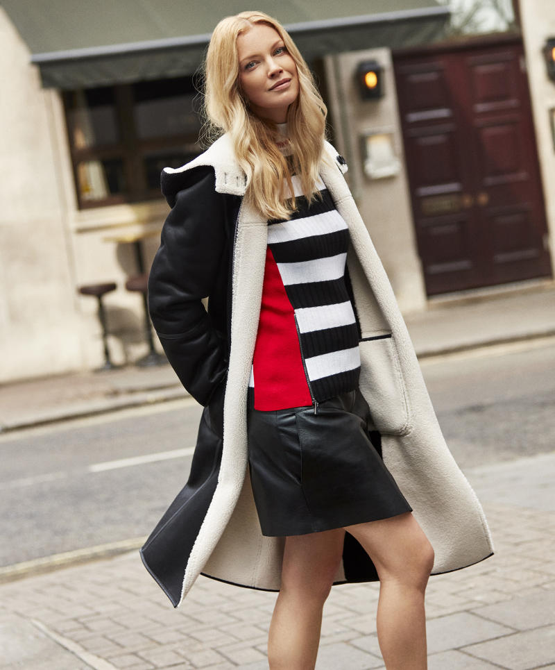 Black Cream Reversible Faux Shearling Coat, £249, Black White Stripe Roll Neck Jumper, £79 and Black Real Leather A-Line Skirt, £249 [Photo: Harpenne]