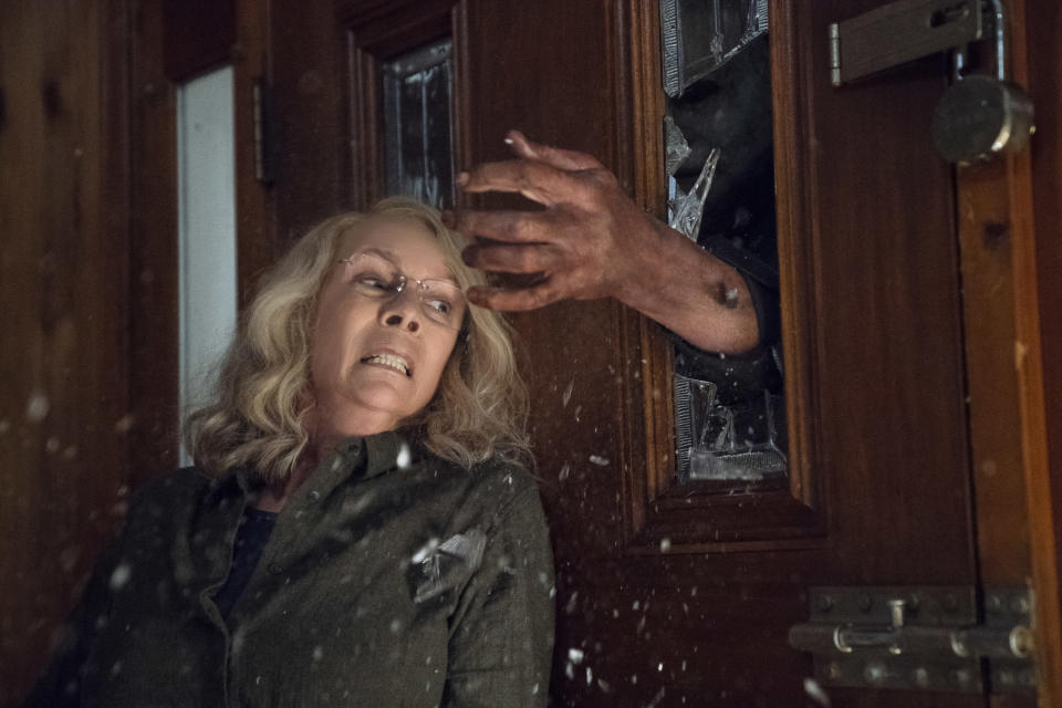 Jamie Lee Curtis and Michael Myers square off again in rebooted <i>Halloween</i>. (Photo: Blumhouse Productions and Miramax)