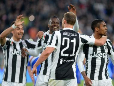 Juventus galloped towards a seventh straight Serie A title with a 3-0 win over Sampdoria on Sunday, pulling six points clear of Napoli whose dwindling championship ambitions were dented by a goalless draw at AC Milan.