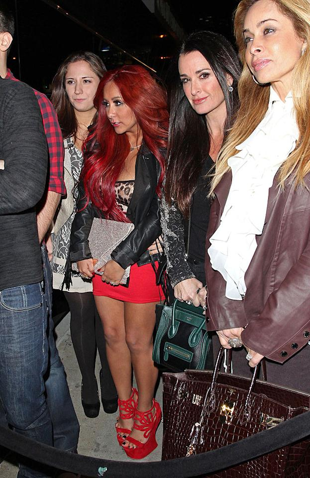 88480, LOS ANGELES, CALIFORNIA - Tuesday December 18, 2012. LADY IN RED!! Nicole 'Snooki' Polizzi seen showing off her new red hair style wearing a matching tight red skirt and red platform shoes while waiting in line with co-star Deena Cortese and 'Real Housewives' star Kyle Richards at Bootsy Bellows in Hollywood. The 24 year old 'Jersey Shore' star who gave birth to her son Lorenzo LaValle in August has flown to Los Angeles to join fellow cast members in a live season finale and host the MTV's Club New Year's Eve event. Photograph: ©David Tonnessen, PacificCoastNews.com **FEE MUST BE AGREED PRIOR TO USAGE** **E-TABLET/IPAD & MOBILE PHONE APP PUBLISHING REQUIRES ADDITIONAL FEES** LOS ANGELES OFFICE: 1 310 822 0419 LONDON OFFICE: 44 20 8090 4079