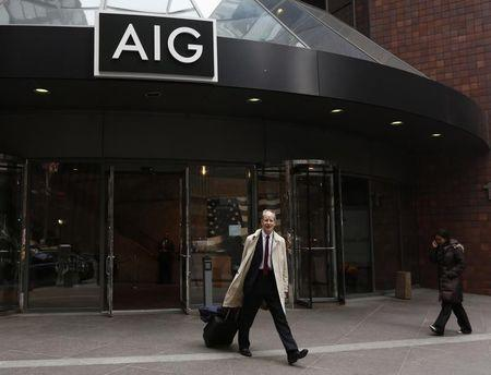 A man exits the AIG headquarters offices in New York's financial district