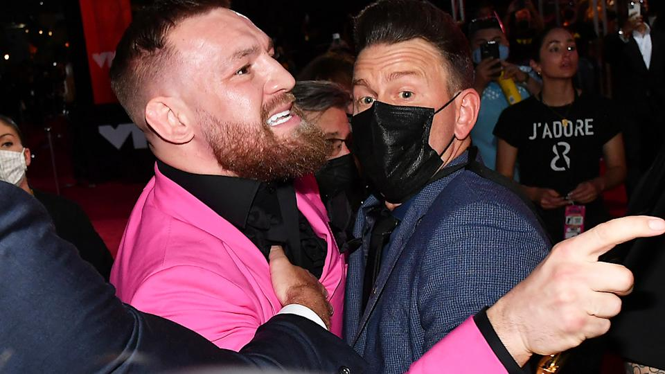 IUFC fighter Conor McGregor had to be held back by security at the MTW Awards after an altercation with rapper Machine Gun Kelly. (Photo by Jeff Kravitz/MTV VMAs 2021/Getty Images for MTV/ViacomCBS)