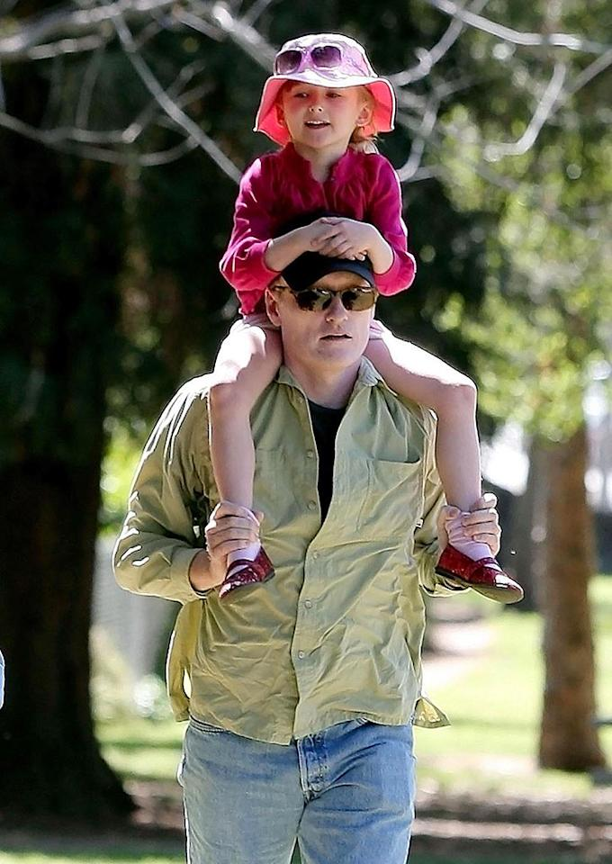 "Five-year-old Neve goes for a ride on dad's shoulders. Must be quite a view from up there -- Conan is 6 feet 4 inches tall! Gaz Shirley/Kevin Perkins/<a href=""http://www.pacificcoastnews.com/"" target=""new"">PacificCoastNews.com</a> - May 31, 2009"