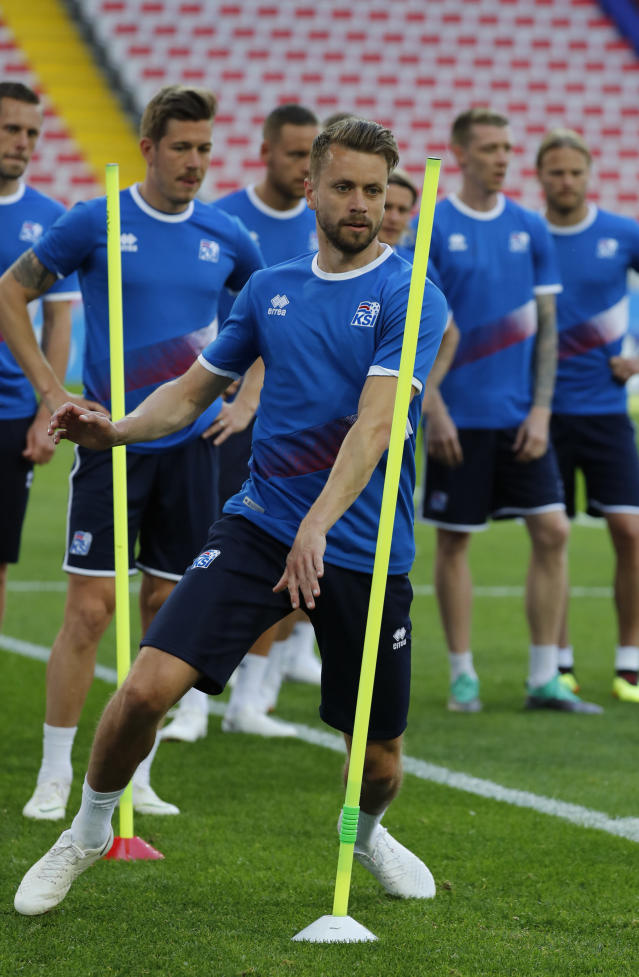 Iceland's Kari Arnason runs through poles during a drill at Iceland's official training on the eve of the group D match between Argentina and Iceland at the 2018 soccer World Cup in Spartak Stadium in Moscow, Russia, Friday, June 15, 2018. (AP Photo/Rebecca Blackwell)