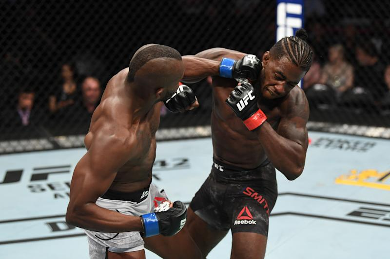 ANAHEIM, CALIFORNIA - AUGUST 17: (L-R) Khama Worthy punches Devonte Smith in their lightweight bout during the UFC 241 event at the Honda Center on August 17, 2019 in Anaheim, California. (Photo by Josh Hedges/Zuffa LLC/Zuffa LLC via Getty Images)
