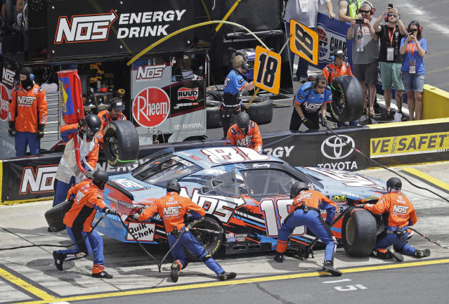 Crew members perform a pit stop on driver Kyle Busch's car during the NASCAR Xfinity series auto race at Charlotte Motor Speedway in Charlotte, N.C., Saturday, May 26, 2018. (AP Photo/Chuck Burton)