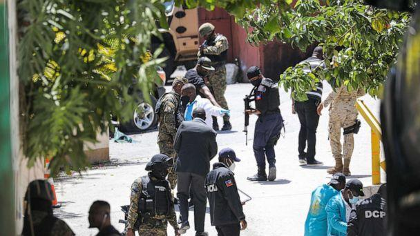 PHOTO: Members of the Haitian police and forensics look for evidence outside of the presidential residence, July 7, 2021, in Port-au-Prince, Haiti.  (Valerie Baeriswyl/AFP via Getty Images)
