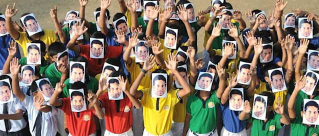 Indian school students wear masks of Sachin Tendulkar at an event to honor him in Nagpur, India, Wednesday, Nov. 13, 2013. Tendulkar will retire from international cricket after playing his 200th test match in Mumbai from Nov. 14-18. (AP Photo)