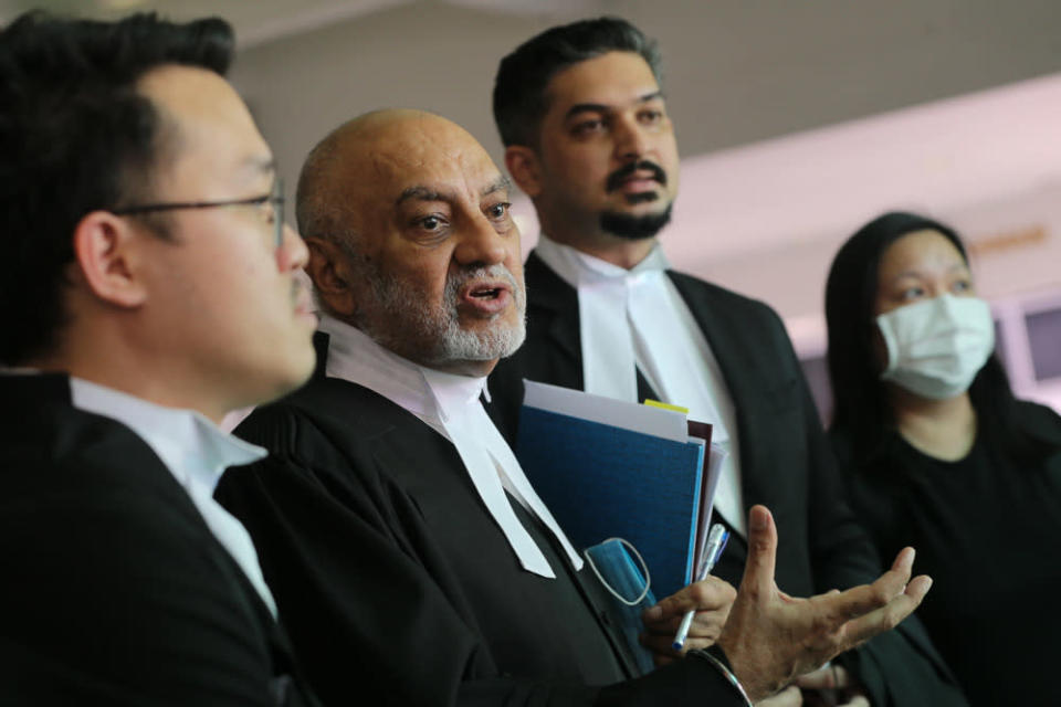 Lawyer Datuk Gurdial Singh Nijar (2nd left) speaks to reporters at the Shah Alam High Court April 23, 2021. — Picture by Yusof Mat Isa