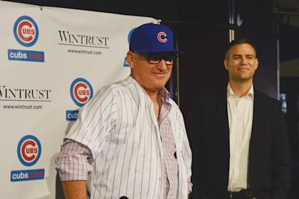 Joe Maddon (left) models his Cubs hat and jersey with president of baseball operations Theo Epstein. (USA TODAY Sports)