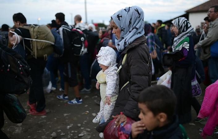 Unlike tens of thousands of other refugees and migrants, some are able to avoid the perilous, exorbitantly-priced land journey through the Balkans and central Europe, thanks to forgers (AFP Photo/Robert Atanasovski)