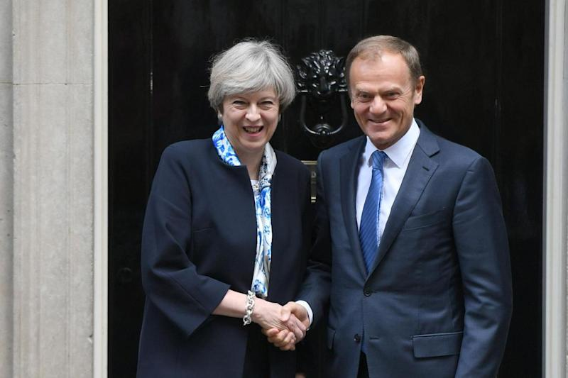 Brexit: Theresa May pictured with Donald Tusk: PA