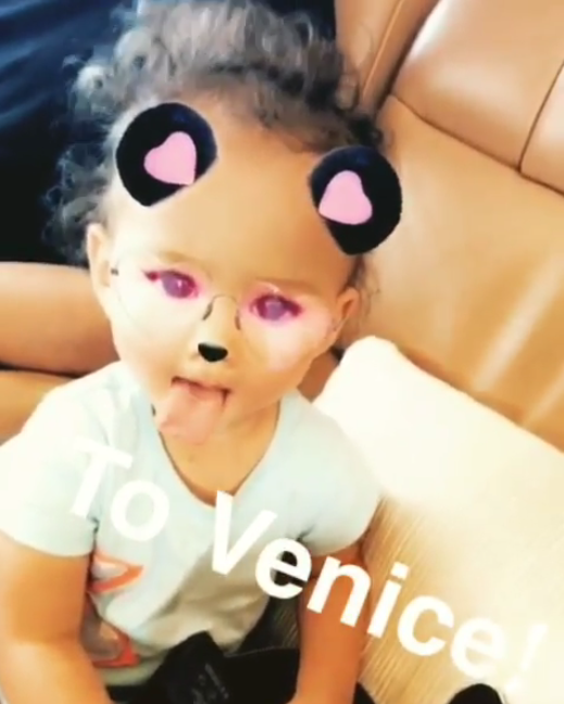 <p>Luna Legend isn't even 2, but she knows how to work a Snapchat filter. What else are you supposed to do en route to Venice? (Photo: Chrissy Teigen via Instagram) </p>