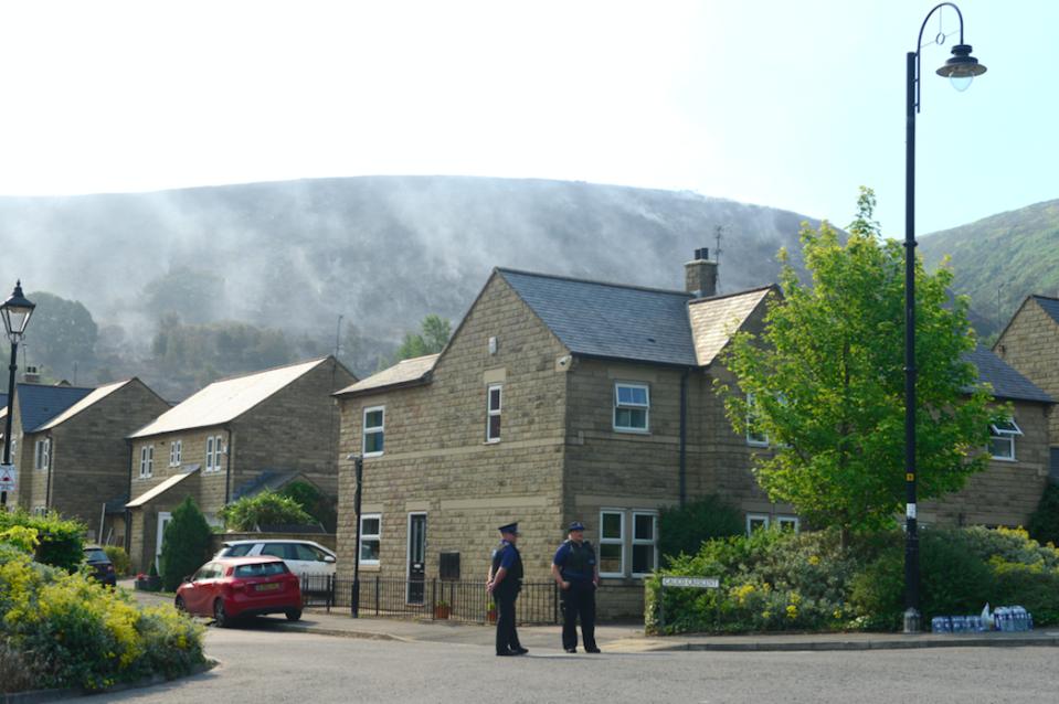 <em>Homes were evacuated in the village of Carrbrook after the fire broke out (SWNS)</em>