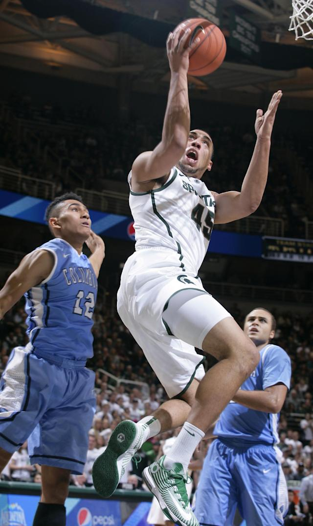 Michigan State's Denzel Valentine (45) puts up a shot between Columbia's Maodo Lo (12) and Isaac Cohen during the second half of an NCAA college basketball game Friday, Nov. 15, 2013, in East Lansing, Mich. Michigan State won 62-53. (AP Photo/Al Goldis)