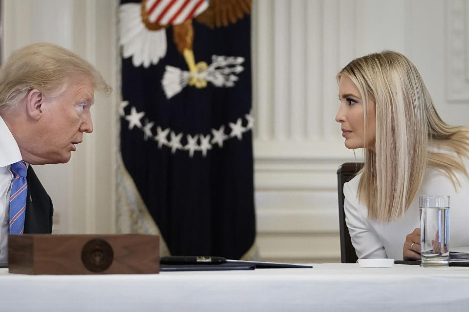 WASHINGTON, DC - JUNE 26: U.S. President Donald Trump talks with White House advisor and daughter Ivanka Trump during a meeting of the American Workforce Policy Advisory Board in the East Room of the White House on June 26, 2020 in Washington, DC. Earlier in the day President Trump canceled his scheduled weekend trip to his private golf club in Bedminster, New Jersey which the state now has a mandatory 14-day quarantine for travelers coming from states with coronavirus spikes. (Photo by Drew Angerer/Getty Images)