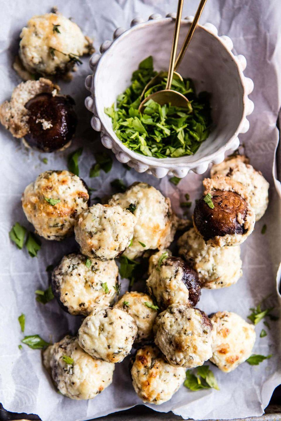 """<p>Take a classic stuffed mushroom dish and turn it into the epitome of a cozy appetizer with herb and goat cheese stuffing.</p><p><strong>Get the recipe at <a href=""""https://www.halfbakedharvest.com/herbed-goat-cheese-stuffed-mushrooms/"""" rel=""""nofollow noopener"""" target=""""_blank"""" data-ylk=""""slk:Half Baked Harvest"""" class=""""link rapid-noclick-resp"""">Half Baked Harvest</a>.</strong> </p>"""