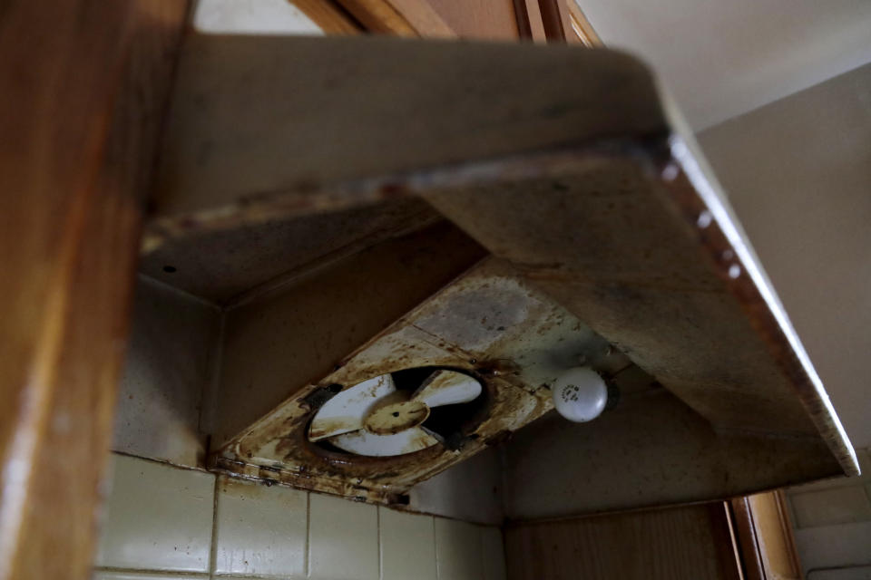 """The oven vent inside Carrie Newson's home at the Dutch Village apartments is seen corroded with mildew, Tuesday, July 30, 2019, in Baltimore. Newson has complained to management about mice and mold in her home but the issues have yet to be fixed. The apartment complex is owned by Jared Kushner, son-in-law of President Donald Trump, who days earlier vilified Congressman Elijah Cummings' majority-black Baltimore district as a """"disgusting, rat and rodent infested mess"""" where """"no human being would want to live."""" (AP Photo/Julio Cortez)"""