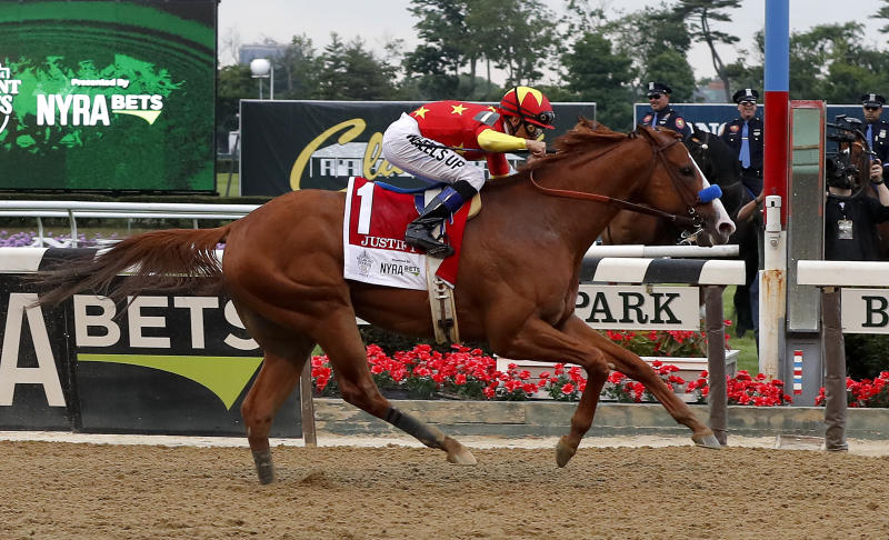 Justify (1), with jockey Mike Smith up, crosses the finish line to win the 150th running of the Belmont Stakes horse race, Saturday, June 9, 2018, in Elmont, N.Y. (AP Photo/Julie Jacobson)