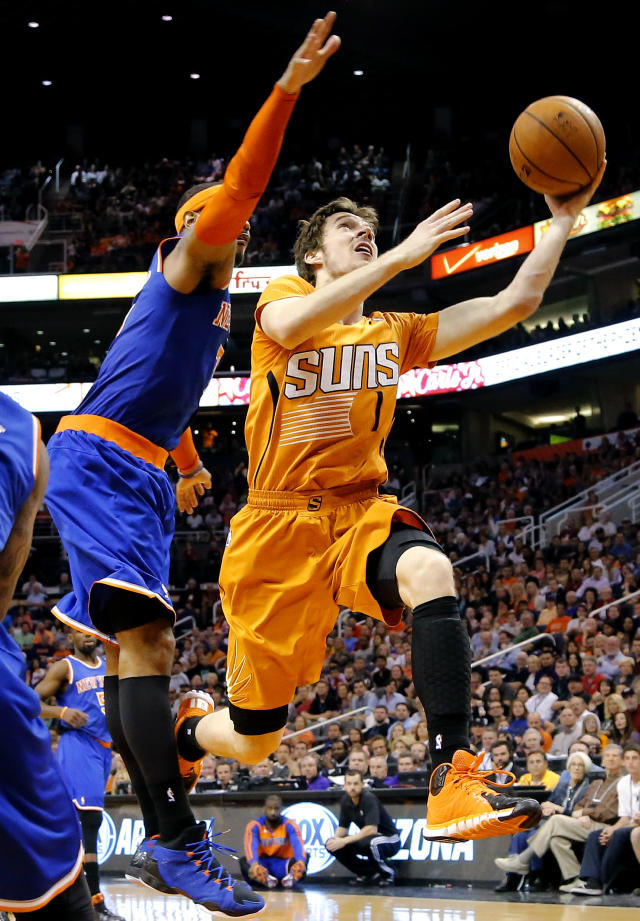 FILE - In this March 28, 2014 file photo, Phoenix Suns' Goran Dragic (1), of Slovenia, drives past New York Knicks' Carmelo Anthony during the second half of an NBA basketball game, in Phoenix. Dragic was selected Wednesday, April 23, 2014 as the league's Most Improved Player. (AP Photo/Matt York, File)