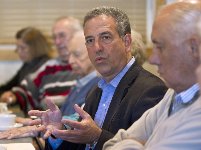 FILE - In this Oct. 12, 2010 file photo, Sen. Russ Feingold, D-Wis. participates in a seniors roundtable event, in Wausau, Wis.  It happens so rarely, it makes news: A few Democratic congressional candidates have dared to run TV ads praising President Barack Obama's divisive health care overhaul. And it won't stop on Nov. 2. It's a political issue the Democrats will have to keep addressing in the next Congress and on into the 2012 campaign.  (AP Photo/Morry Gash, File)
