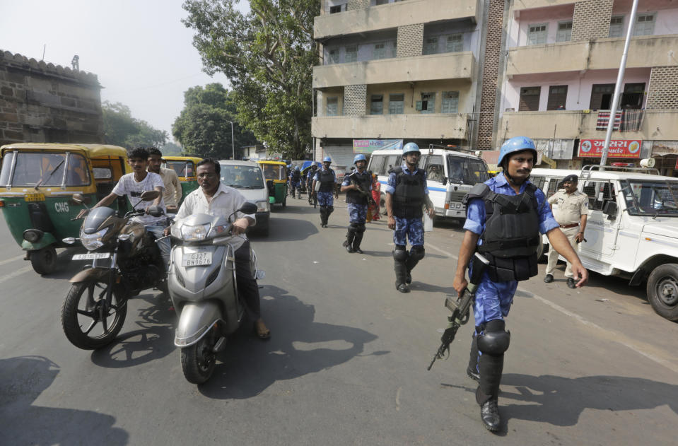 Rapid Action Force (RAF) personnel patrol a street in Ahmadabad, India, Saturday, Nov. 9, 2019. India's Supreme Court has ruled in favor of a Hindu temple on a disputed religious ground and ordered that alternative land be given to Muslims. The dispute over land ownership has been one of the country's most contentious issues. (AP Photo/Ajit Solanki)