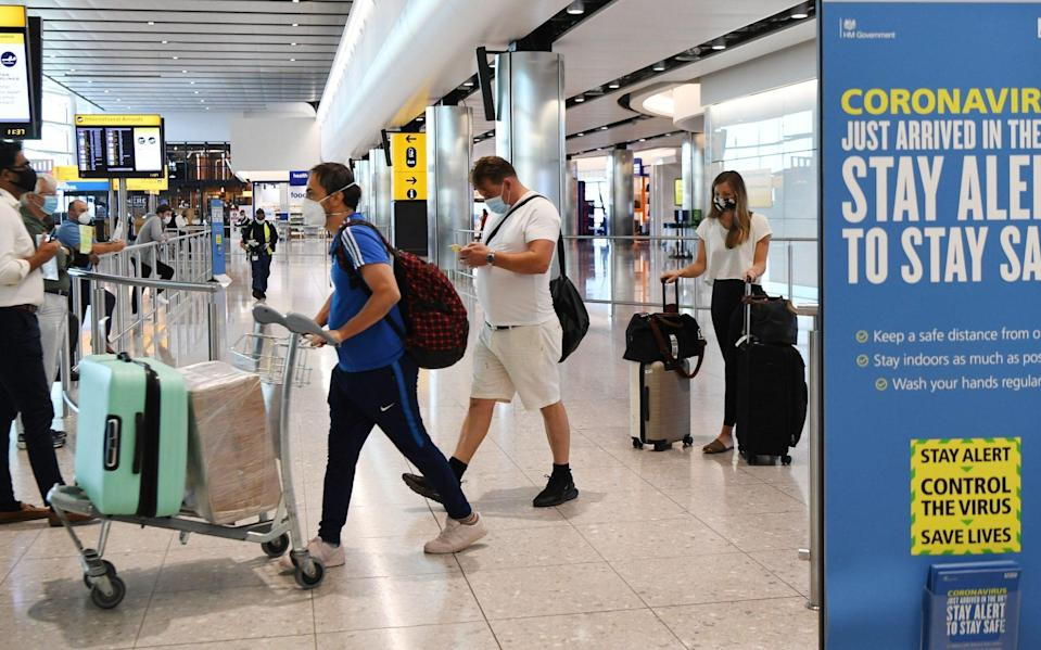 Passengers arrive at Heathrow Airport in London, Britain, 30 July 2020. - Andy Rain/EPA-EFE/Shutterstock