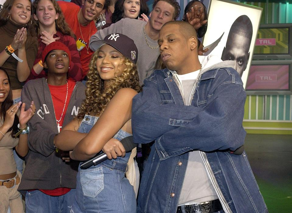 <p>Beyoncé and Jay Z wore matching denim when they appeared on <b>TRL</b> together in 2002.</p>
