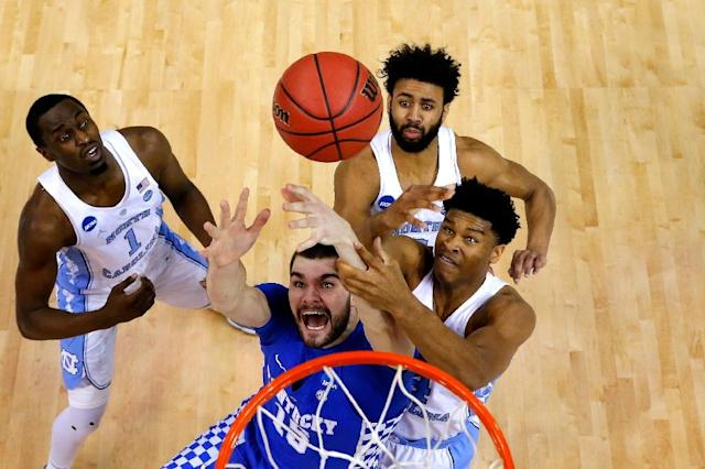 Isaac Humphries of the Kentucky Wildcats competes for a rebound with Theo Pinson, Isaiah Hicks and Joel Berry II of the North Carolina Tar Heels in the first half during the 2017 NCAA Men's Basketball Tournament March 26, 2017 in Memphis, Tennessee (AFP Photo/ANDY LYONS)