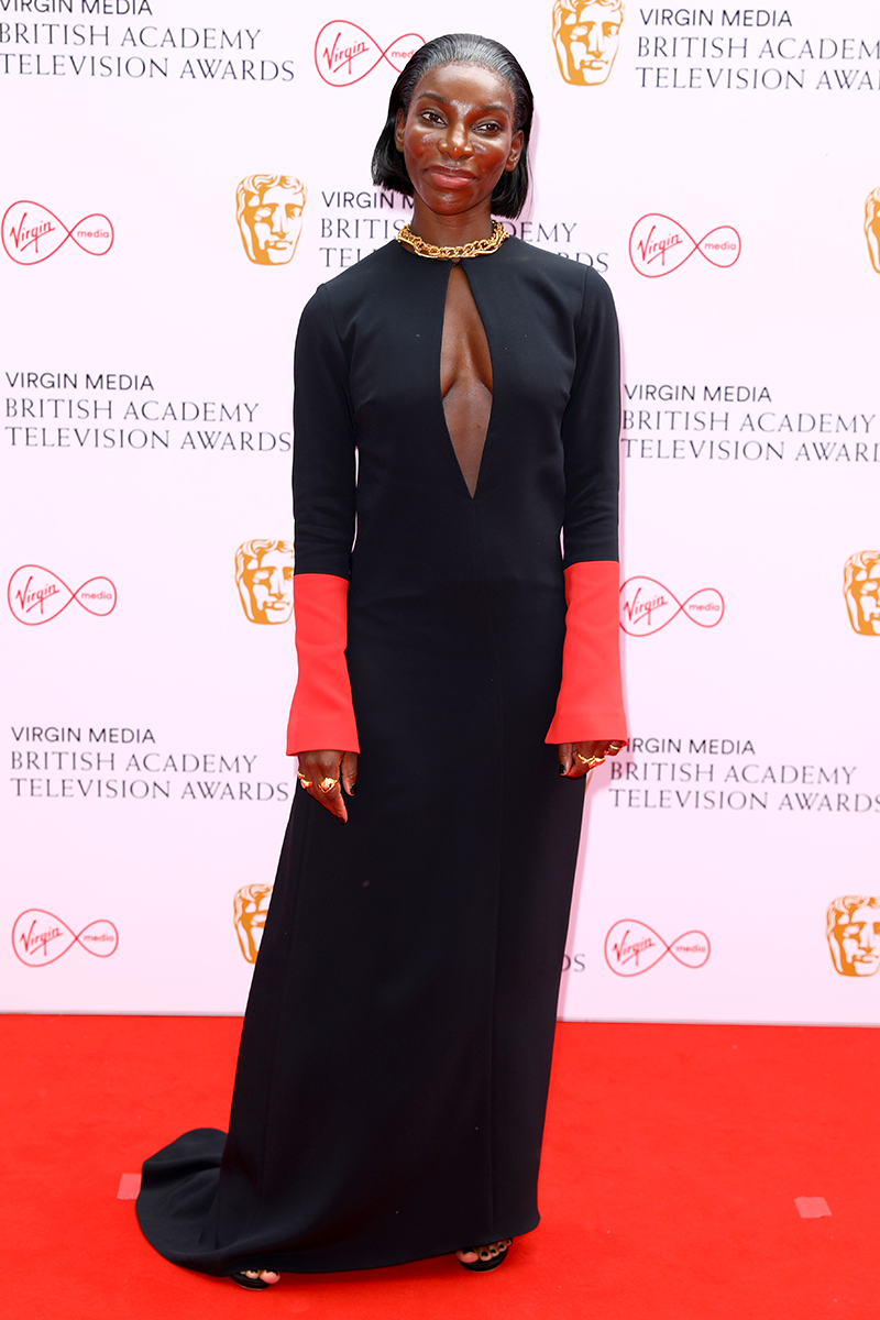 """<p>Michaela Coel wears this cut out detail dress, one of this season's <a href=""""https://www.cosmopolitan.com/uk/fashion/style/a35267349/spring-summer-2021-fashion-trends/"""" rel=""""nofollow noopener"""" target=""""_blank"""" data-ylk=""""slk:biggest trends"""" class=""""link rapid-noclick-resp"""">biggest trends</a>, like a total pro.</p>"""