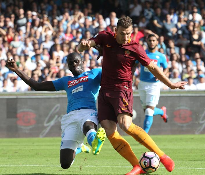 Edin Dzeko (right) took his Serie A tally to seven with a brace for Roma in a 3-1 at Napoli on October 15, 2016 (AFP Photo/Carlo Hermann)