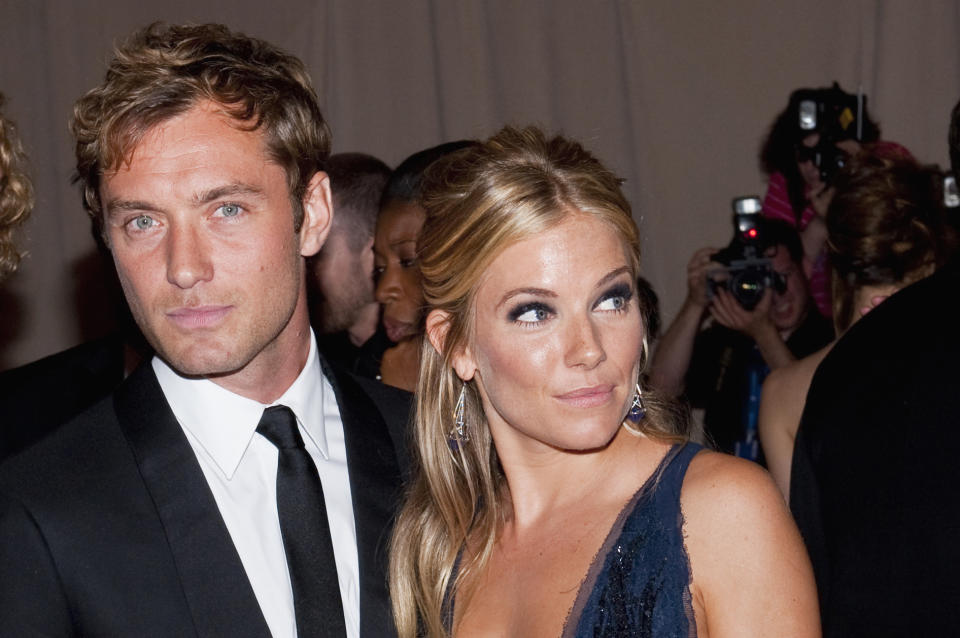 """Jude Law and Sienna Miller attend """"American Woman: Fashioning A National Identity"""" Costume Institute Gala at The Metropolitan Museum of Art in New York City. (Photo by LAN/Corbis via Getty Images)"""