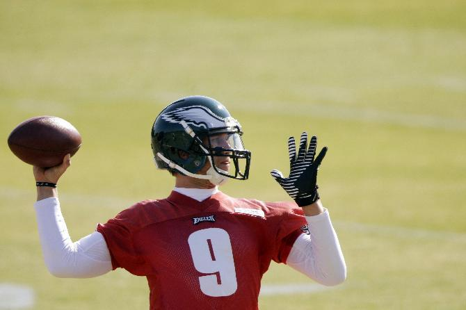 Philadelphia Eagles quarterback Nick Foles throws a pass during practice at the NFL football team's training facility, Tuesday, Oct. 29, 2013, in Philadelphia. (AP Photo/Matt Rourke)