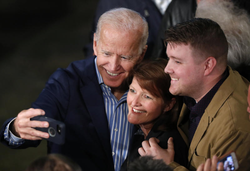 Former Vice President and Democratic presidential candidate Joe Biden poses for photos with audience members during a rally, Wednesday, May 1, 2019, in Des Moines, Iowa. (AP Photo/Charlie Neibergall)