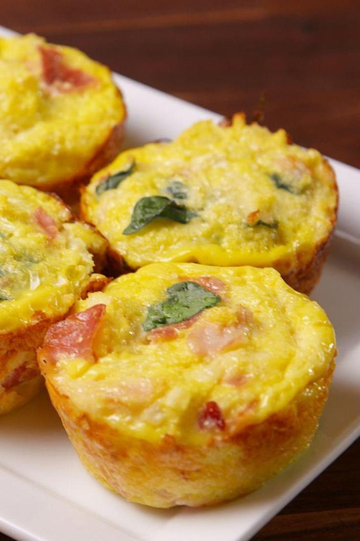 """<p><span>A healthy breakfast you can take on-the-go!</span></p><p><span>Get the recipe from </span><a href=""""https://www.delish.com/cooking/recipes/a51528/cauliflower-breakfast-muffins-recipe/"""" rel=""""nofollow noopener"""" target=""""_blank"""" data-ylk=""""slk:Delish"""" class=""""link rapid-noclick-resp"""">Delish</a><span>.</span><br></p>"""