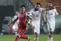 South Korea's Kwon Chang-hoon, left, fights for the ball with Lebanon's Hassan Saad during the final round of the Asian zone group A qualifying soccer match for the World Cup Qatar 2022 at Suwon World Cup stadium in Suwon, South Korea, Tuesday, Sept. 7, 2021. (AP Photo/Ahn Young-joon)