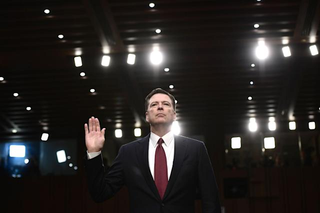 <p>Former FBI Director James Comey takes the oath before he testifies during a US Senate Select Committee on Intelligence hearing on Capitol Hill in Washington, DC, June 8, 2017. (Photo: Brendan Smialowski/AFP/Getty Images) </p>