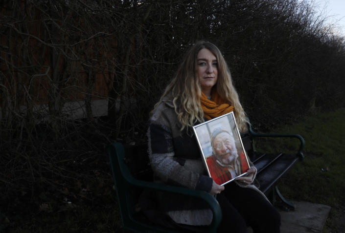 """FILE - In this Friday, Jan. 22, 2021 file photo, Jo Goodman holds a portrait of her late father Stuart as she poses for a photo in London. Britain's Prime Minister Boris Johnson will on Tuesday, Sept. 28 finally meet with members of the COVID-19 Bereaved Families for Justice campaigning group, who for more than a year have sharply criticized his handling of the coronavirus pandemic. Johnson's Downing Street office confirmed Monday that the prime minister will hold a """"private meeting"""" with members of the group. (AP Photo/Alastair Grant, file)"""