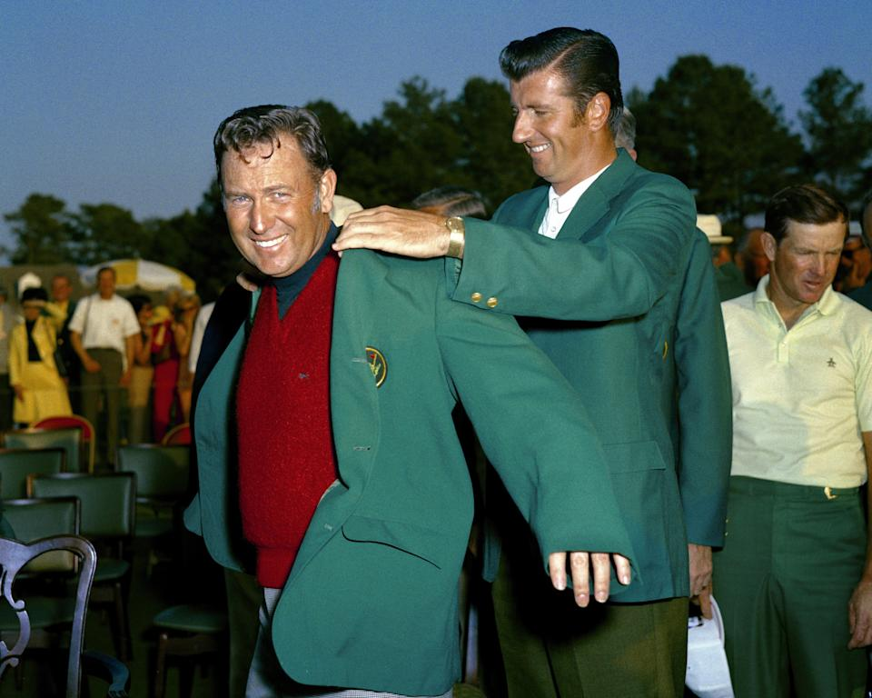 Billy Casper receives his green jacket in 1970 from George Archer. (Photo by Augusta National/Getty Images)