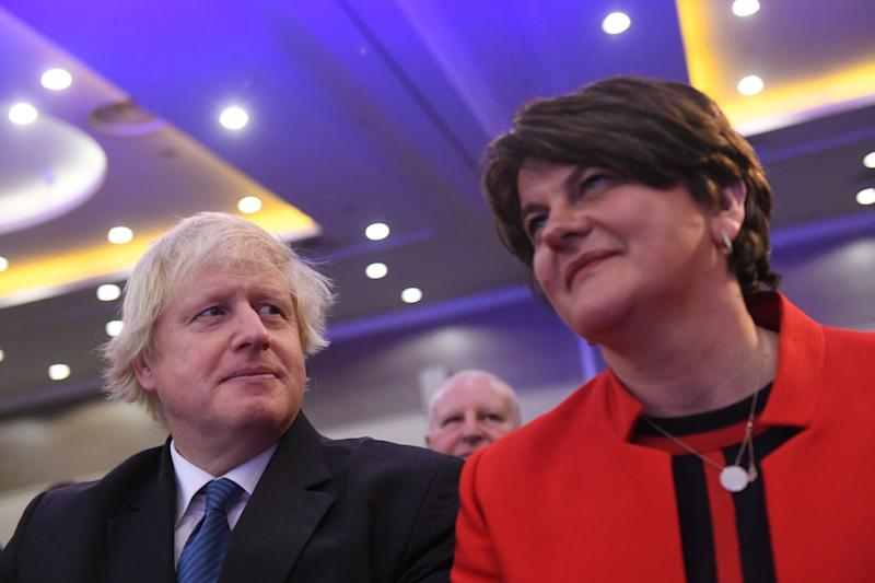 Democratic Unionist Party (DUP) leader Arlene Foster sits next to Conservative MP Boris Johnson, at the DUP annual party conference in Belfast, Northern Ireland November 24, 2018. REUTERS/Clodagh Kilcoyne