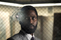 """This image released by Warner Bros. Entertainment shows John David Washington in a scene from """"Tenet."""" Warner Bros. says it is delaying the release of Christopher Nolan's sci-fi thriller """"Tenet"""" until Aug. 12. (Melinda Sue Gordon/Warner Bros. Entertainment via AP)"""