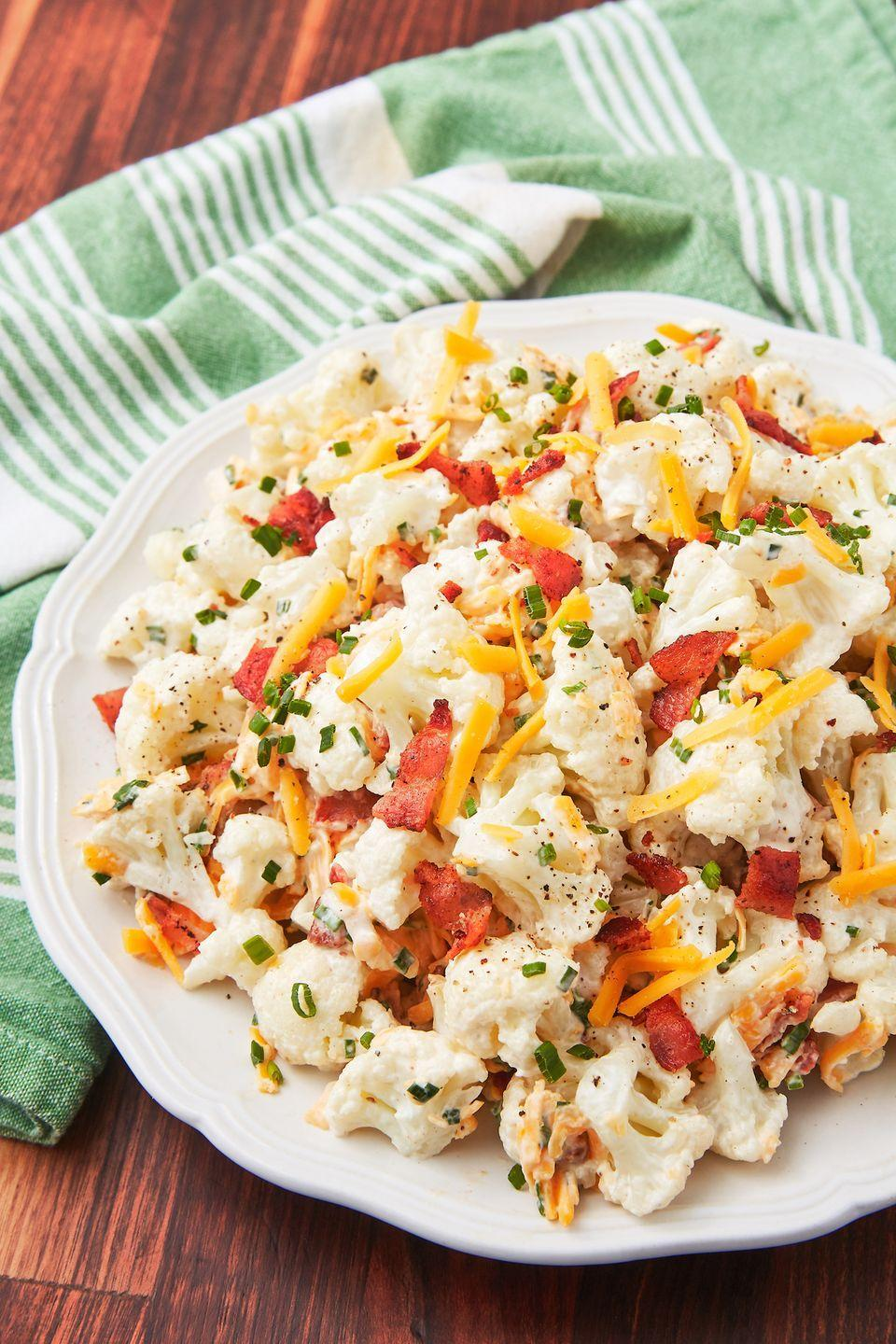 """<p>This is our first time making fauxtato salad with lots of bacon and cheese. And guess what? We have zero regrets about it. </p><p>Get the recipe from <a href=""""https://www.delish.com/cooking/recipe-ideas/a22128352/loaded-cauliflower-salad-recipe/"""" rel=""""nofollow noopener"""" target=""""_blank"""" data-ylk=""""slk:Delish"""" class=""""link rapid-noclick-resp"""">Delish</a>.</p>"""